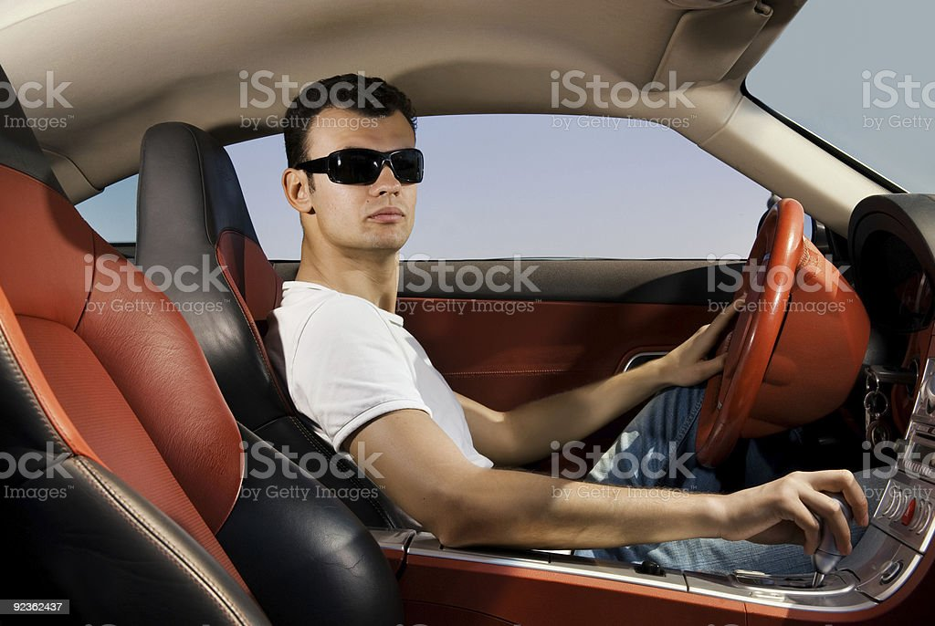 Handsome young man driving modern sport car royalty-free stock photo