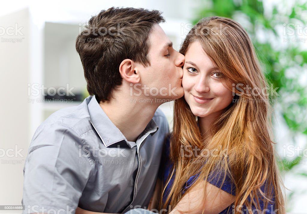 Handsome young man embracing his girlfriend with love royalty-free stock photo