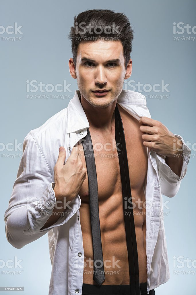Handsome young man getting dressed royalty-free stock photo
