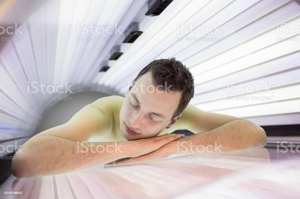 Handsome young man in a modern solarium stock photo