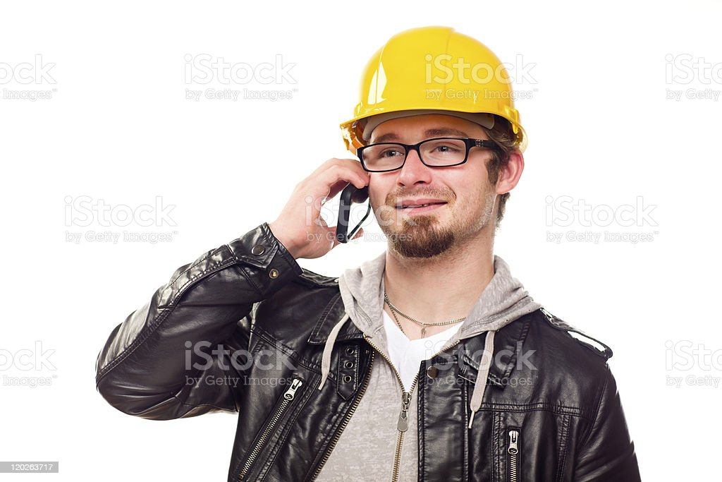 Handsome Young Man in Hard Hat on Phone royalty-free stock photo