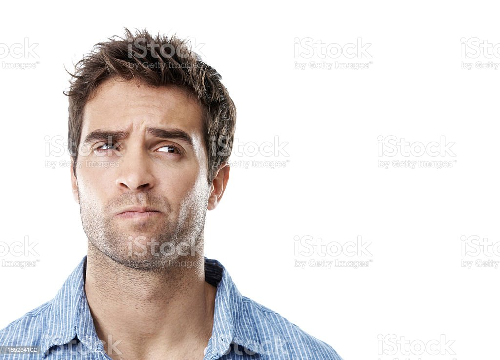 Handsome young man in striped shirt with a frown stock photo