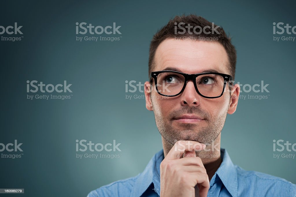 A handsome young man in thought stock photo