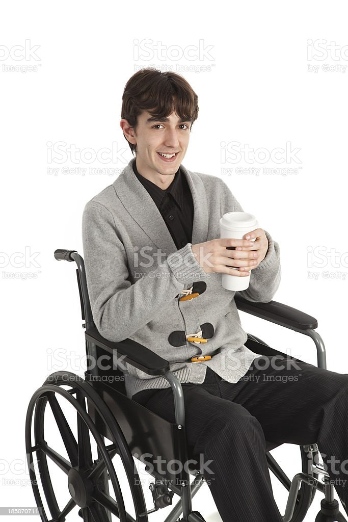Handsome Young Man In Wheelchair With Coffee stock photo