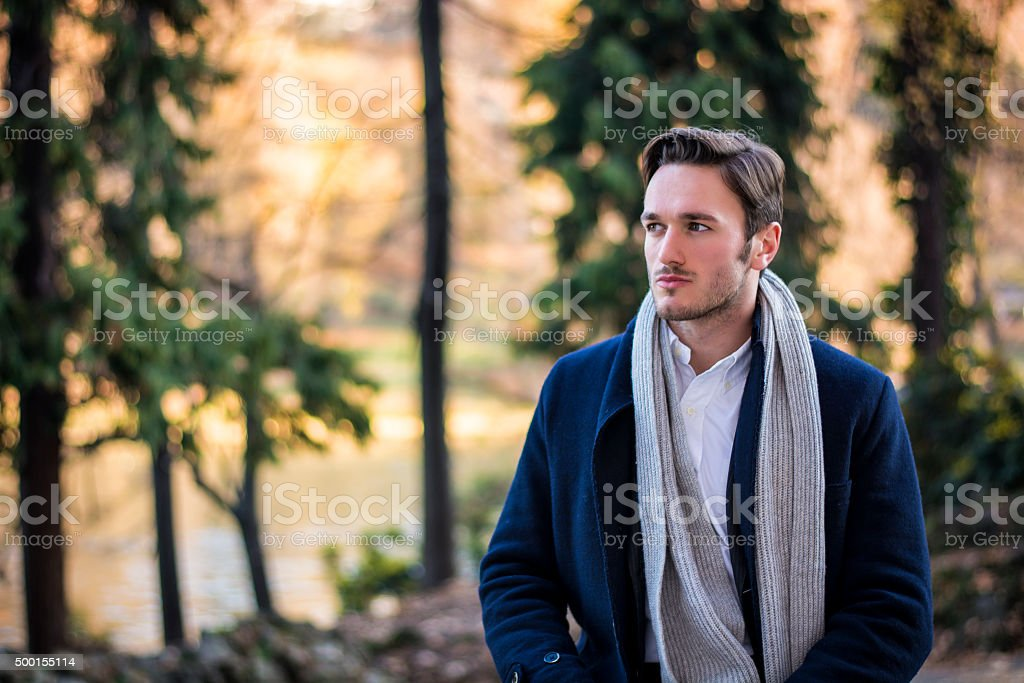Handsome young man outdoor in winter fashion stock photo