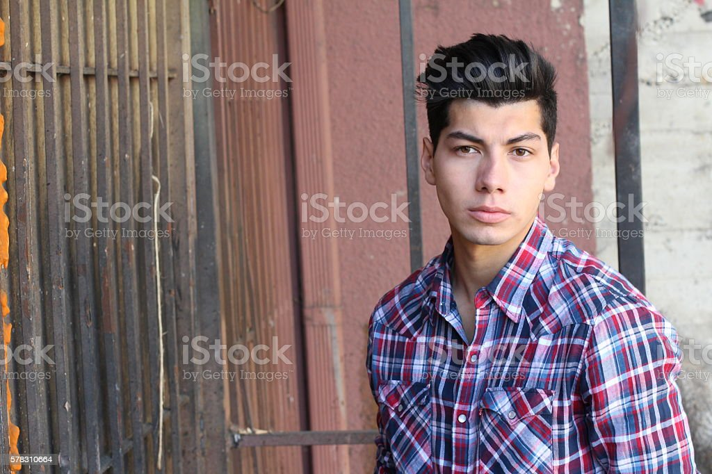 Handsome young man outdoors in downtownn stock photo