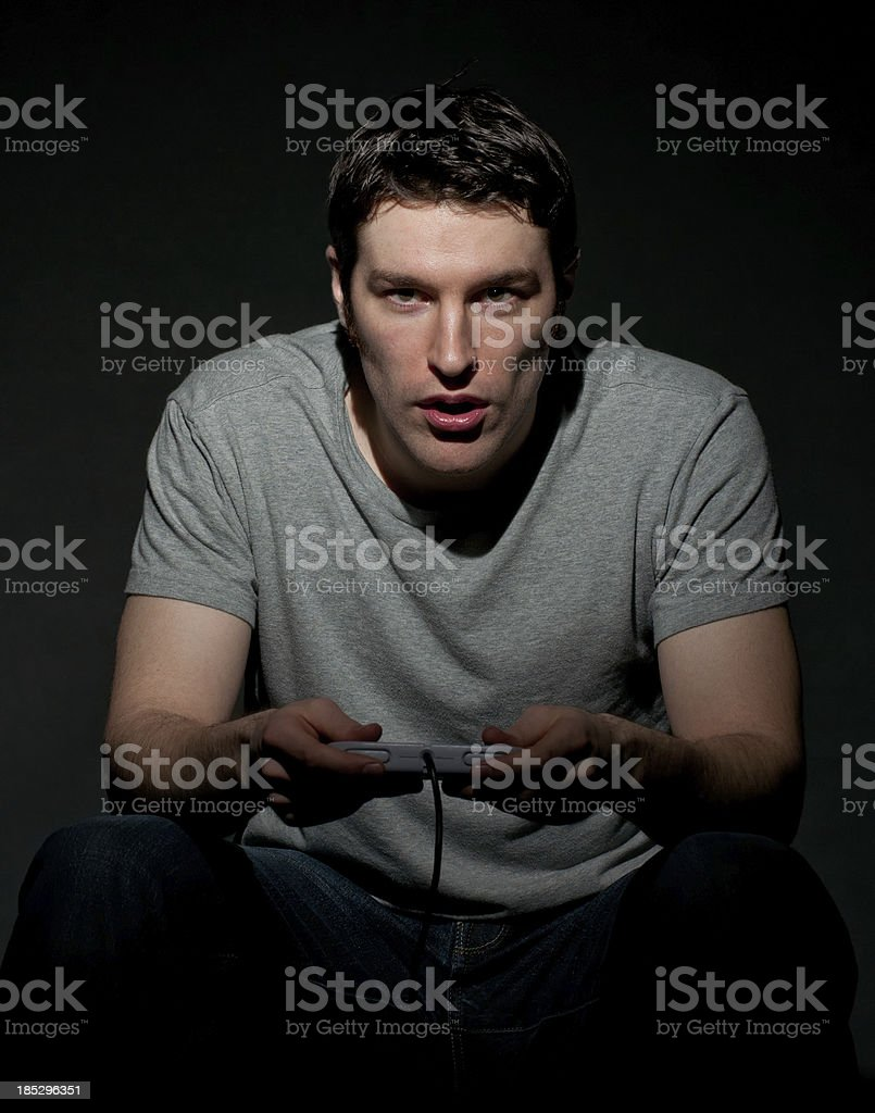 Handsome Young Man Playing Video Game stock photo