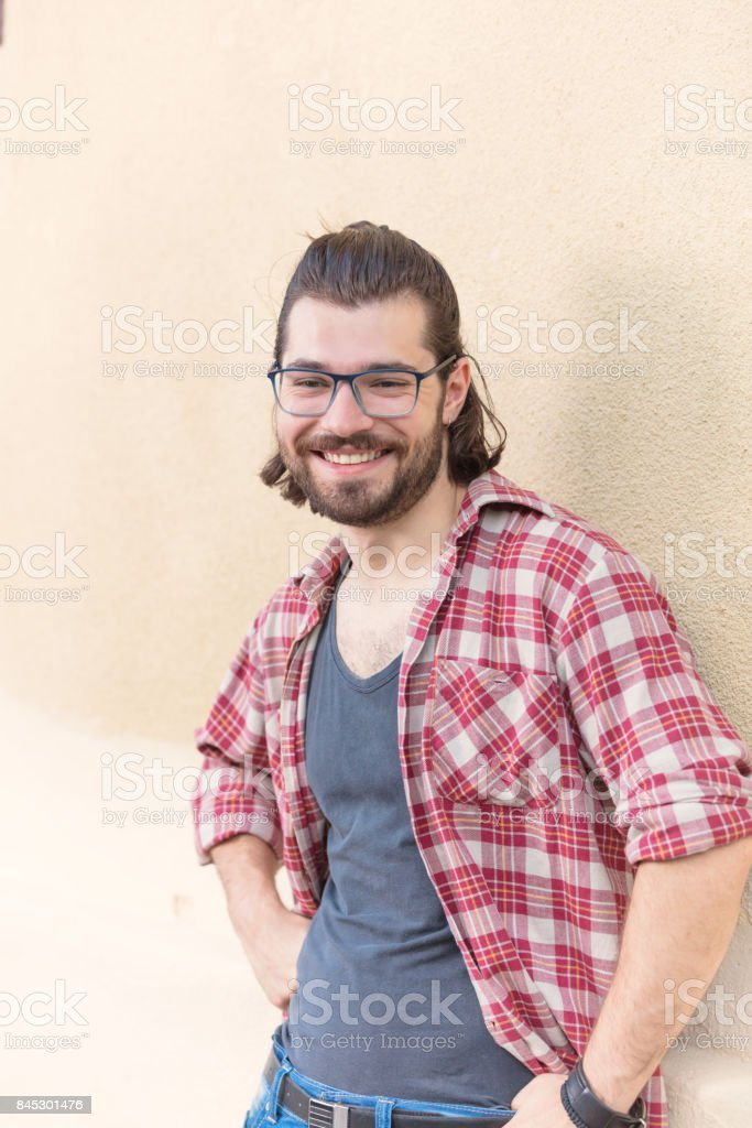 Handsome young man posing in front of the camera. stock photo