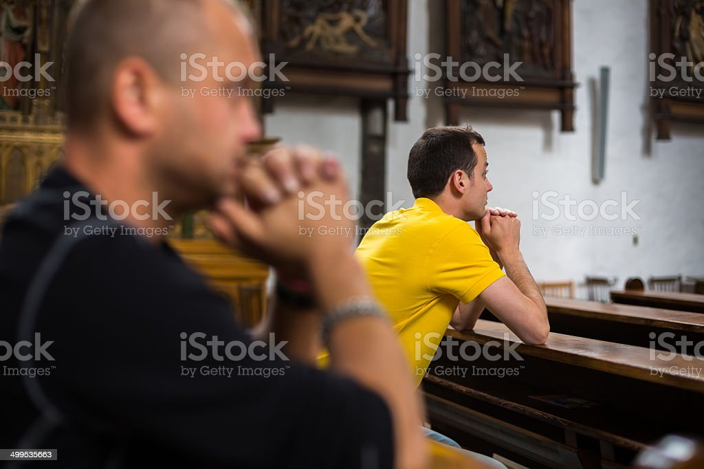 Handsome young man praying stock photo