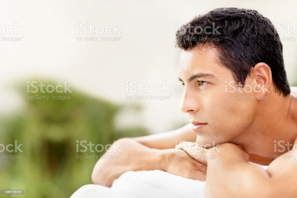 Handsome young man resting at an outdoor spa stock photo
