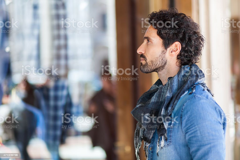 Handsome young man shopping stock photo
