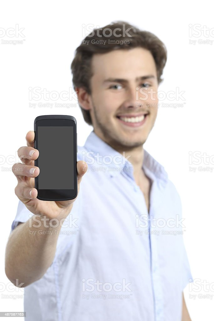 Handsome young man showing a blank smart phone screen stock photo