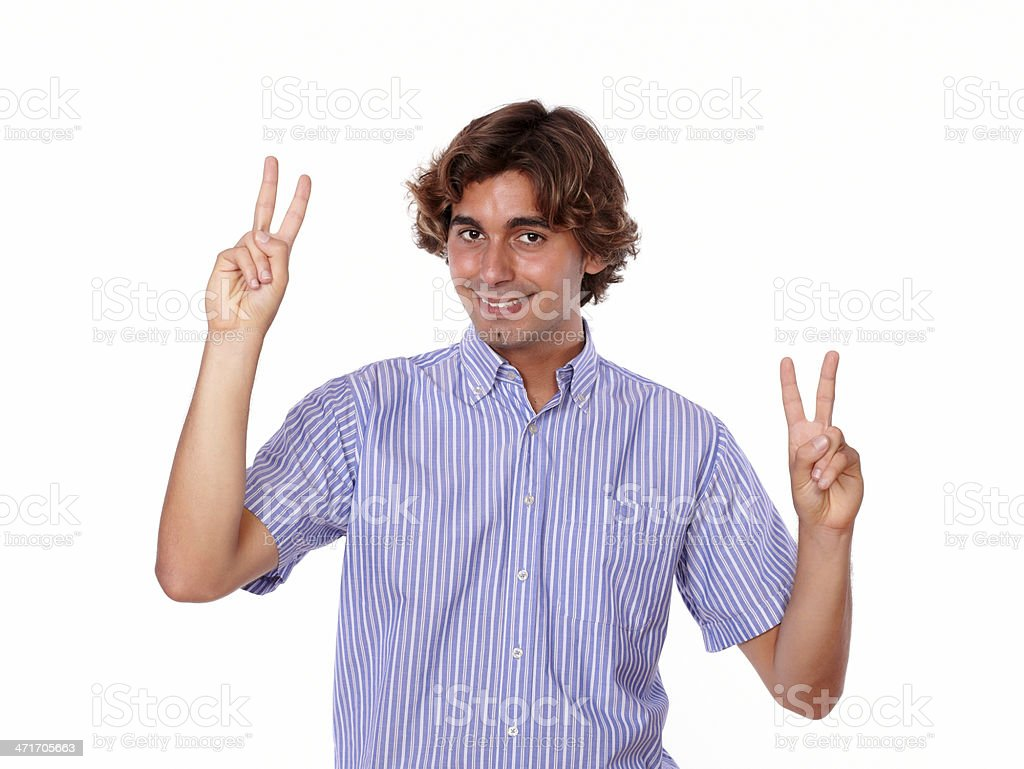 Handsome young man showing you victory sign royalty-free stock photo