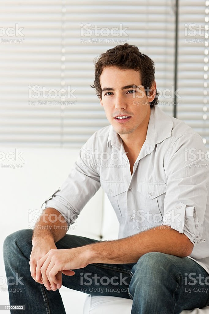 Handsome young man sitting at home royalty-free stock photo