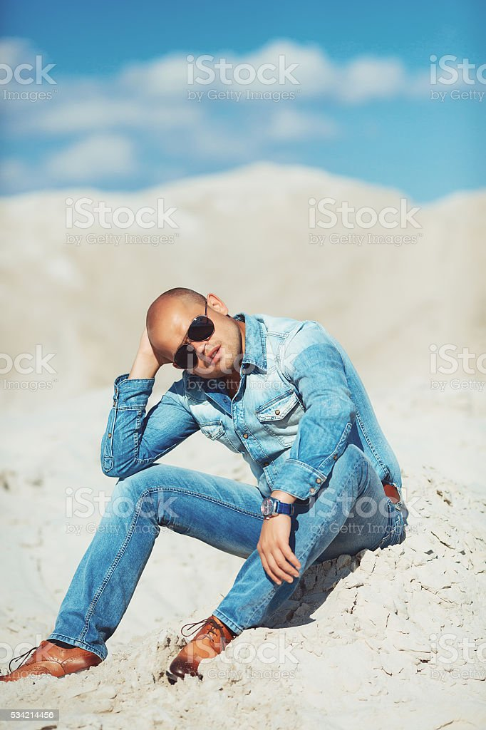 handsome young man smiling outdoors royalty-free stock photo