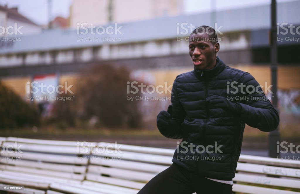 Handsome Young Man Stretching At Park stock photo
