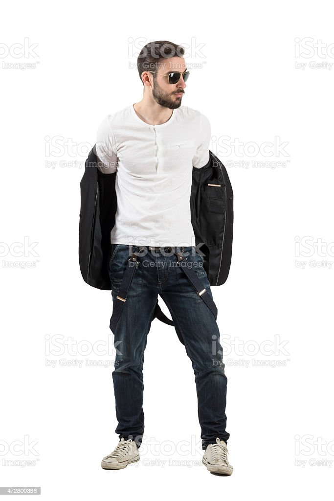 Handsome young man taking off jacket stock photo
