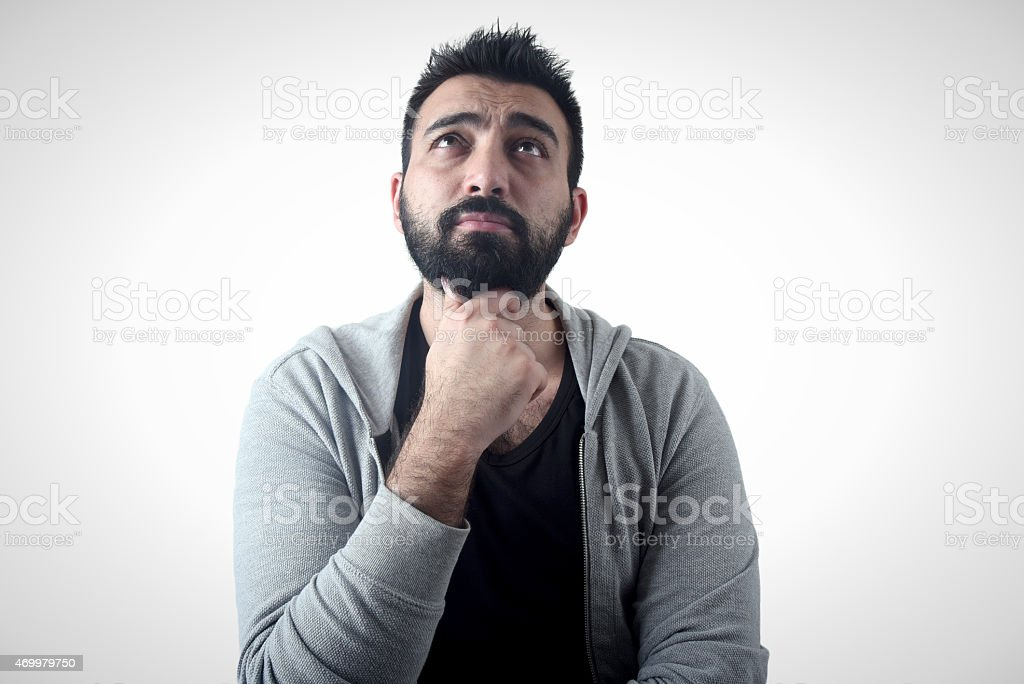 handsome young man thinking stock photo
