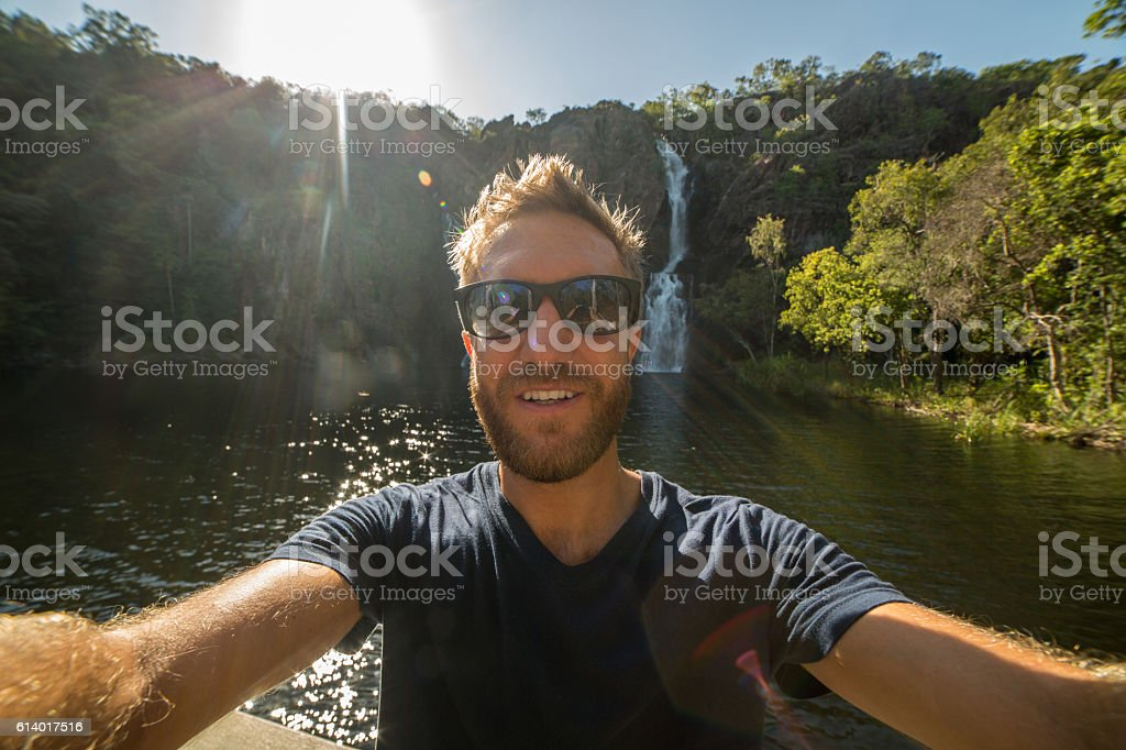 Handsome young man traveling takes selfie portrait stock photo