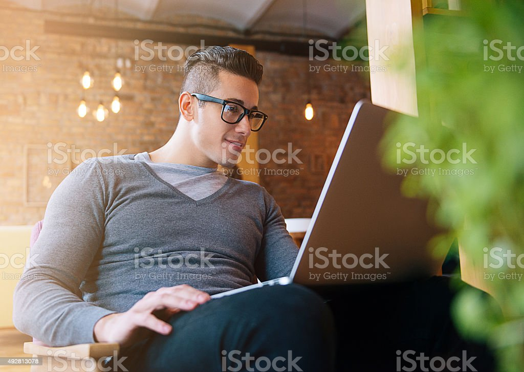 Handsome young man using notebook computer for start-up business stock photo