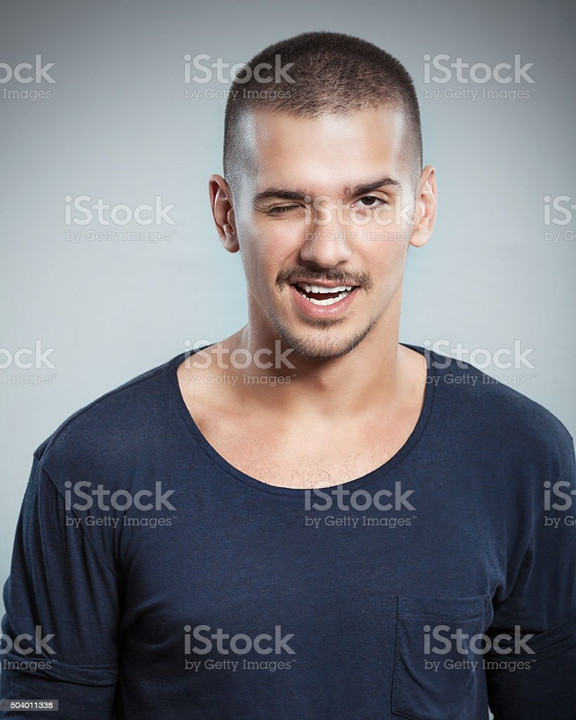 Handsome Young Man Winking stock photo