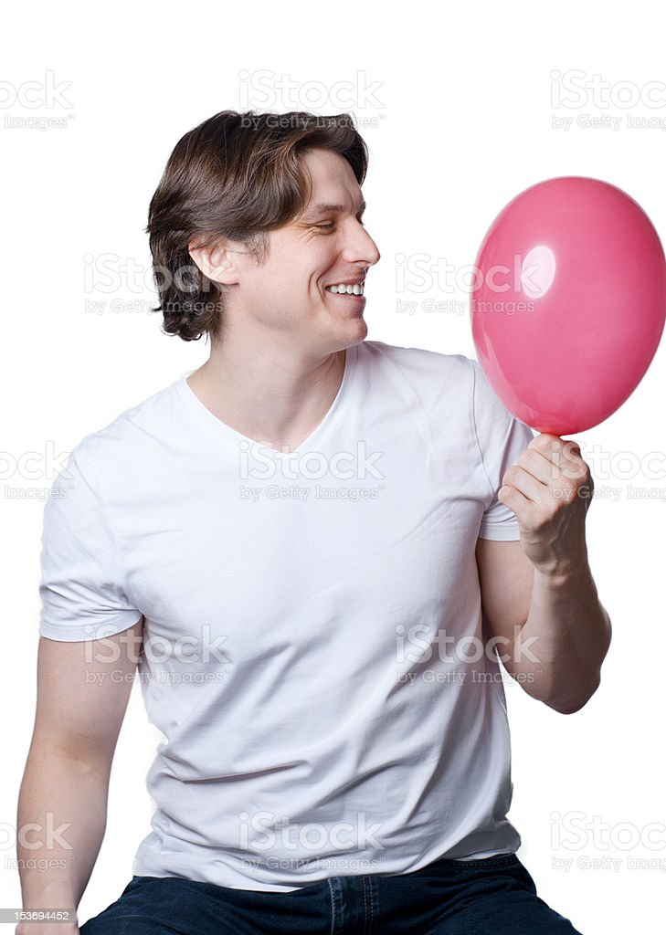 Handsome young man with a pink  balloon royalty-free stock photo