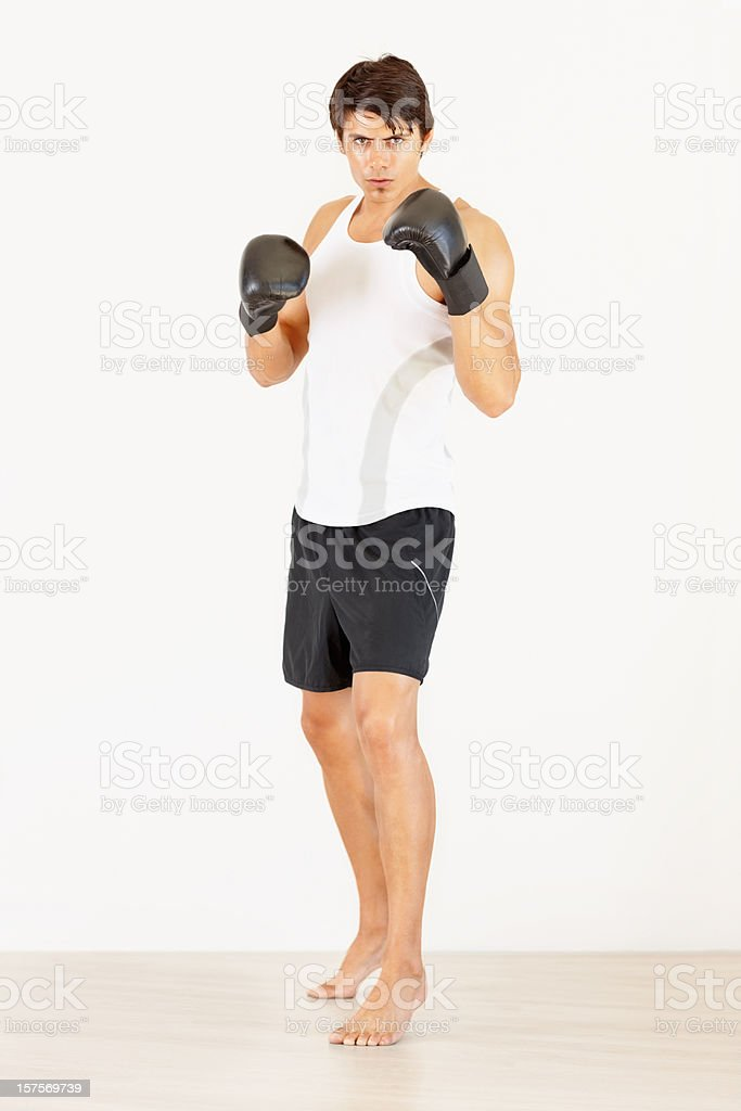 Handsome young man with boxing gloves ready to fight royalty-free stock photo