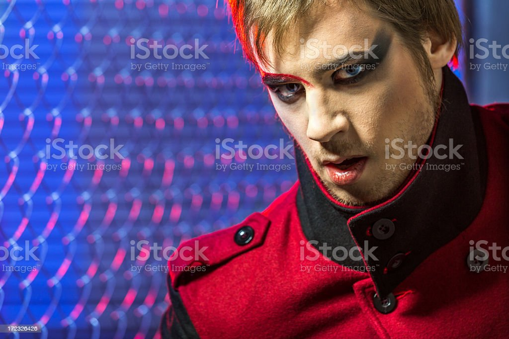 Handsome young man with evil eyes royalty-free stock photo