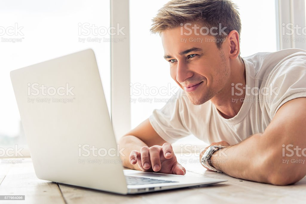 Handsome young man with gadget stock photo