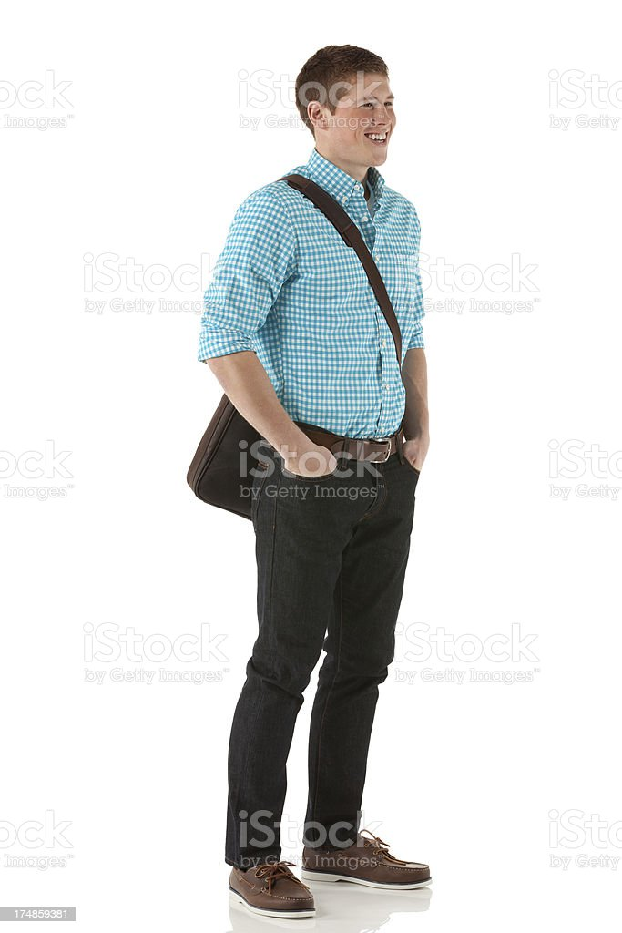 Handsome young man with hands in pockets royalty-free stock photo