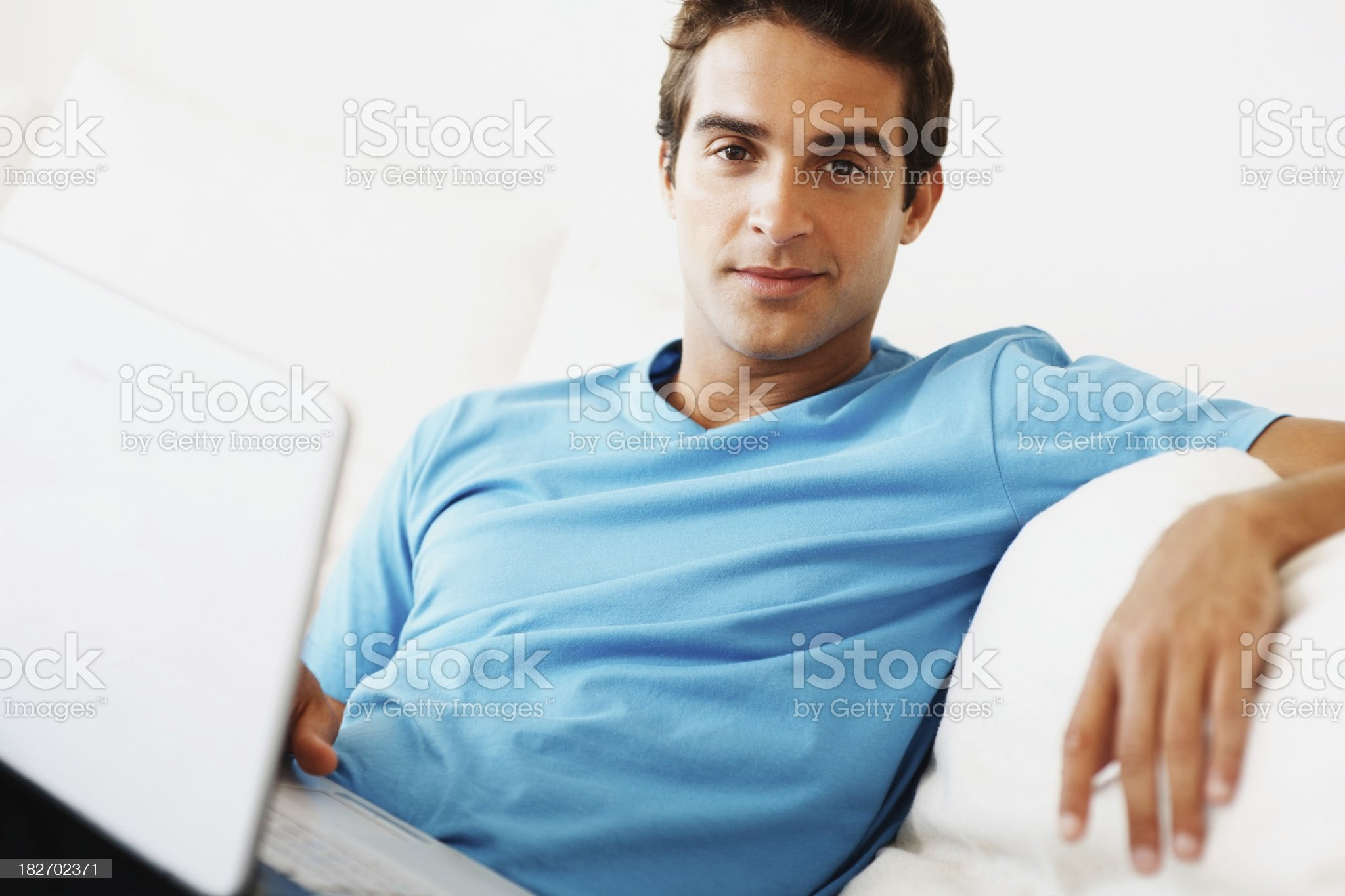 Handsome young man with laptop at home royalty-free stock photo