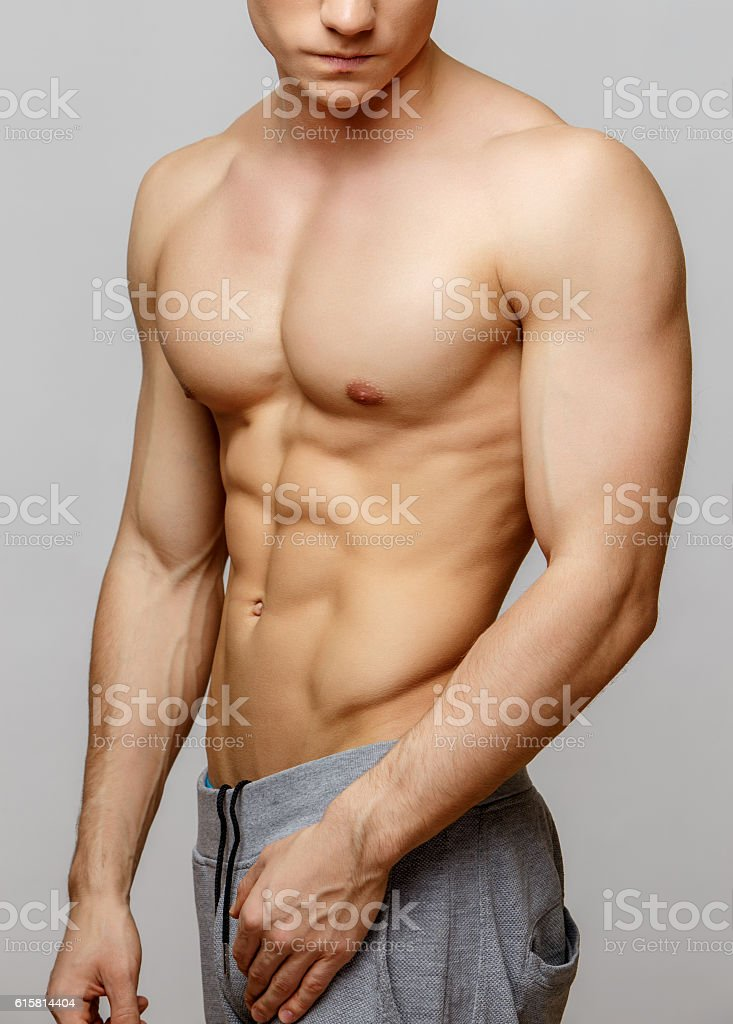 Handsome young man's torso stock photo