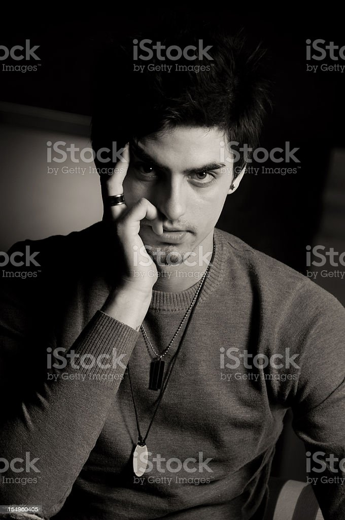 Handsome young men posing in dark ambient royalty-free stock photo