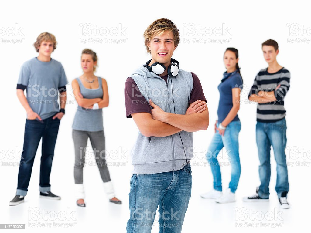 Handsome young men with friends in the background royalty-free stock photo