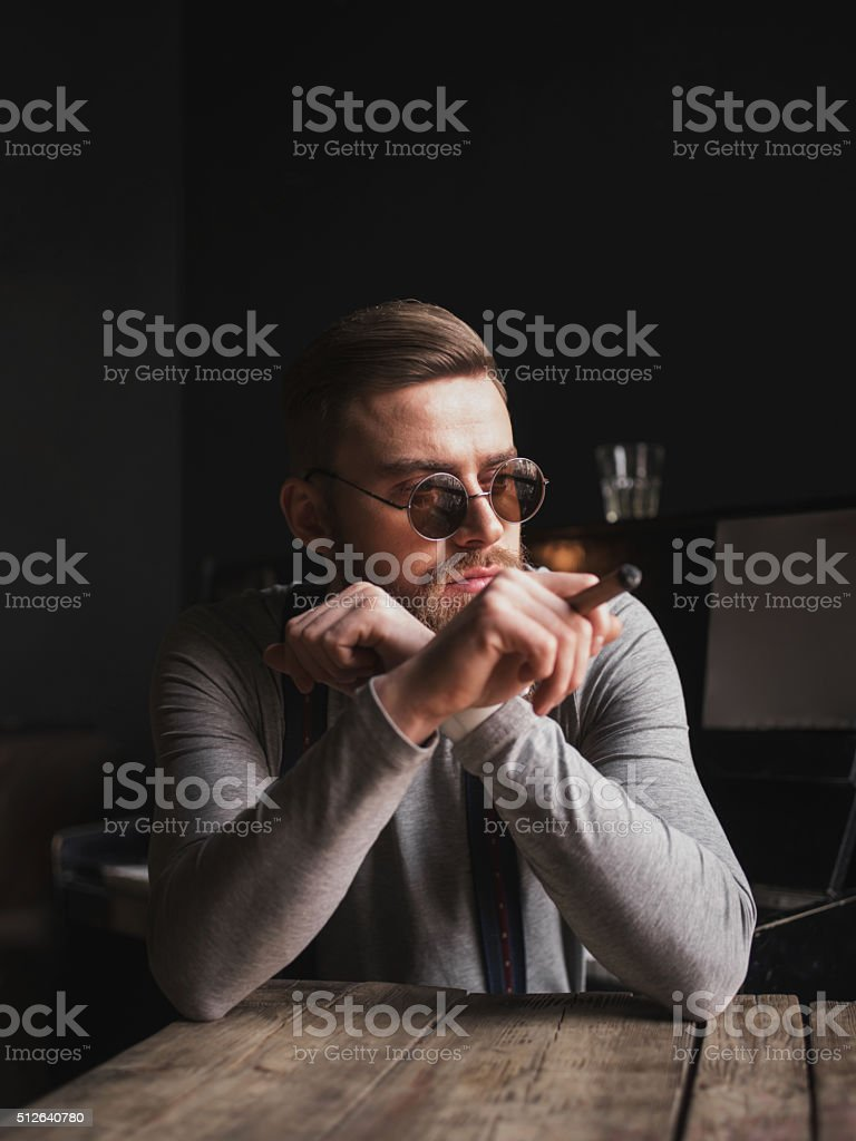 Handsome young musician is resting after performance stock photo