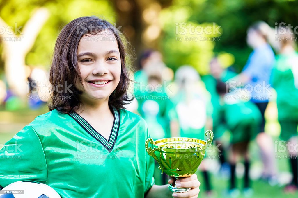 Handsome young soccer player with championship trophy stock photo