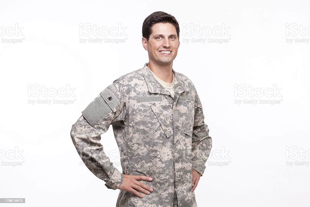 Handsome young soldier posing with hands on hips royalty-free stock photo