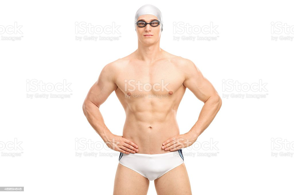 Handsome young swimmer in white swim trunks stock photo