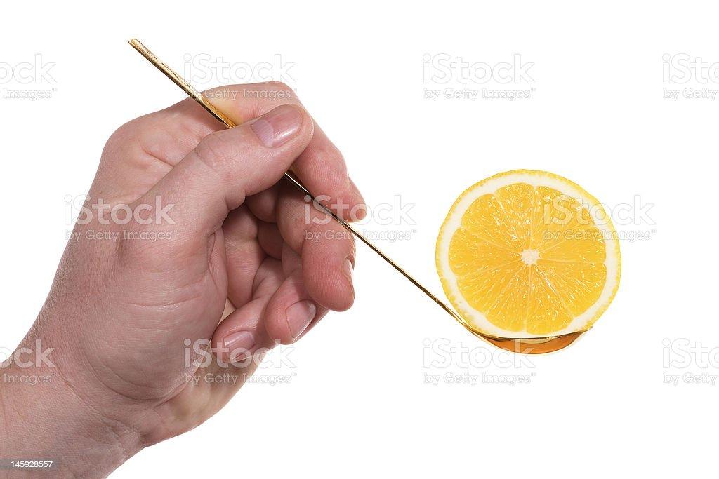 Hand,spoon,lemon royalty-free stock photo