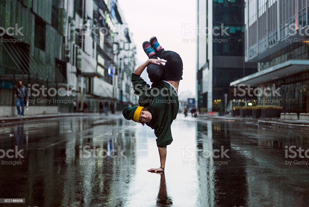 Handstand dancer in the street, teenage dancer stock photo