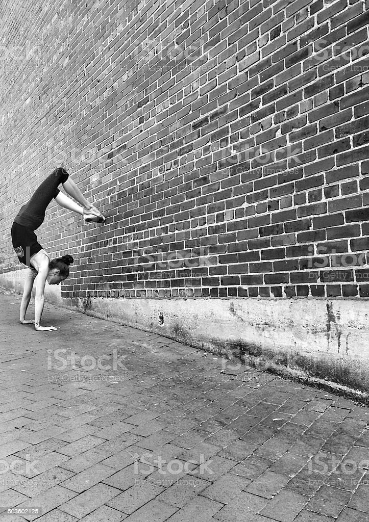 Handstand in Alley with Brick Wall stock photo