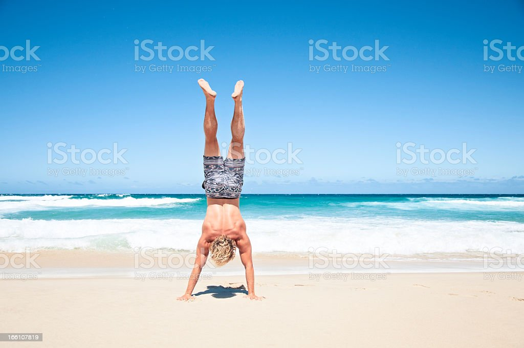 Handstand On Beach stock photo