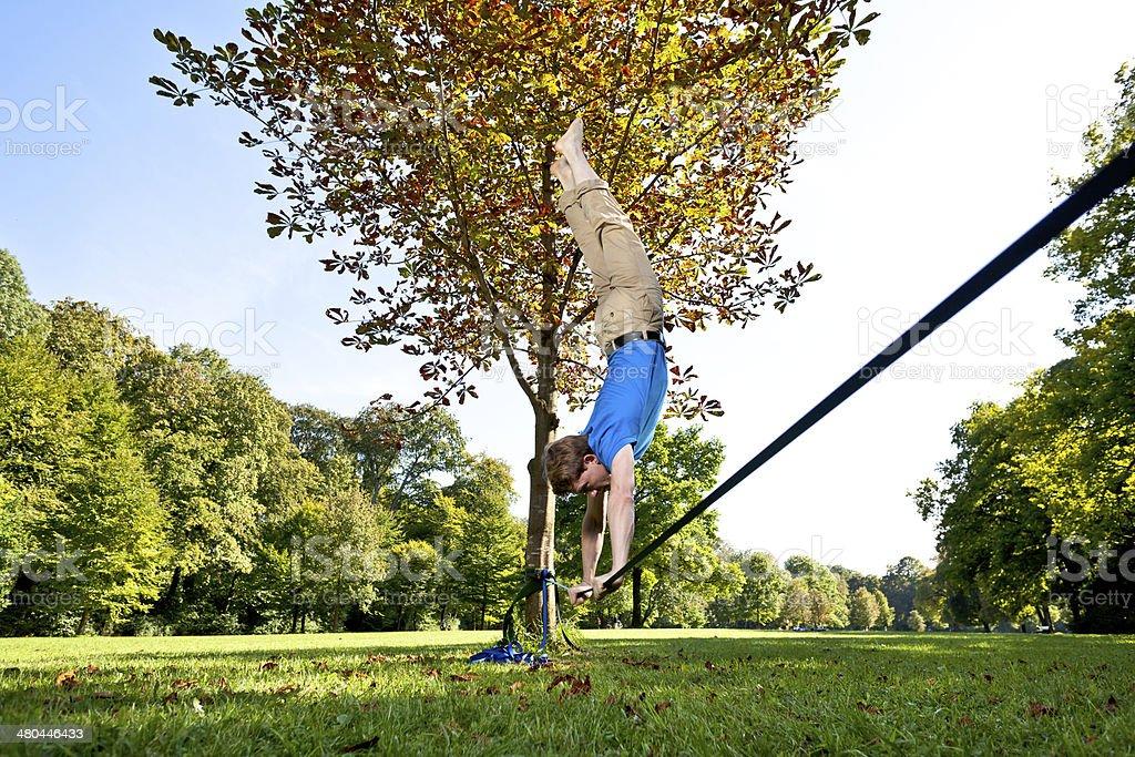 handstand on slackline landscape format stock photo