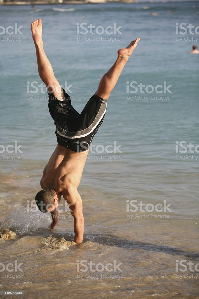 Handstand on the beach royalty-free stock photo