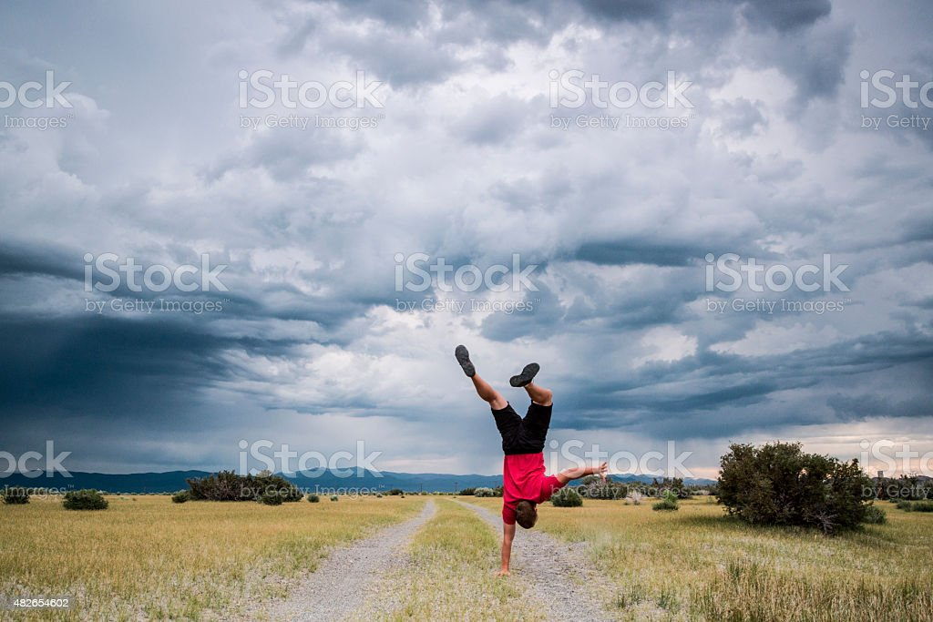 Handstand outdoors stock photo