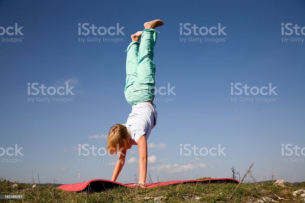 Handstanding girl royalty-free stock photo