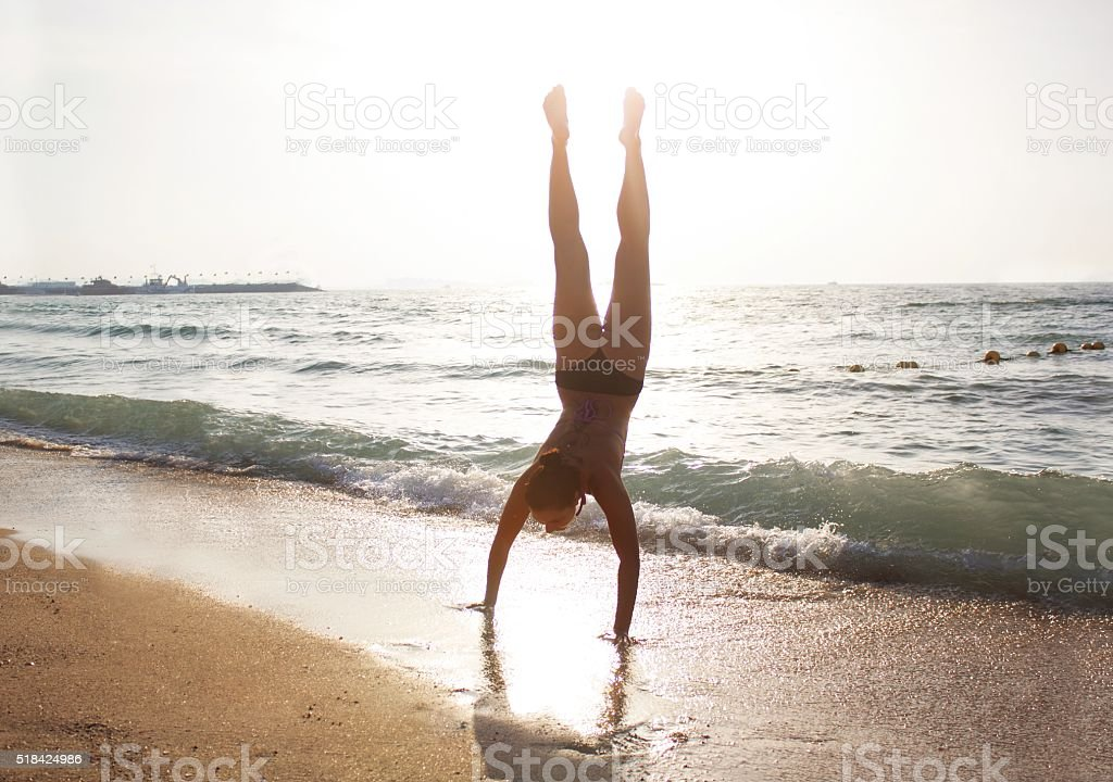 Handstands on the Beach stock photo