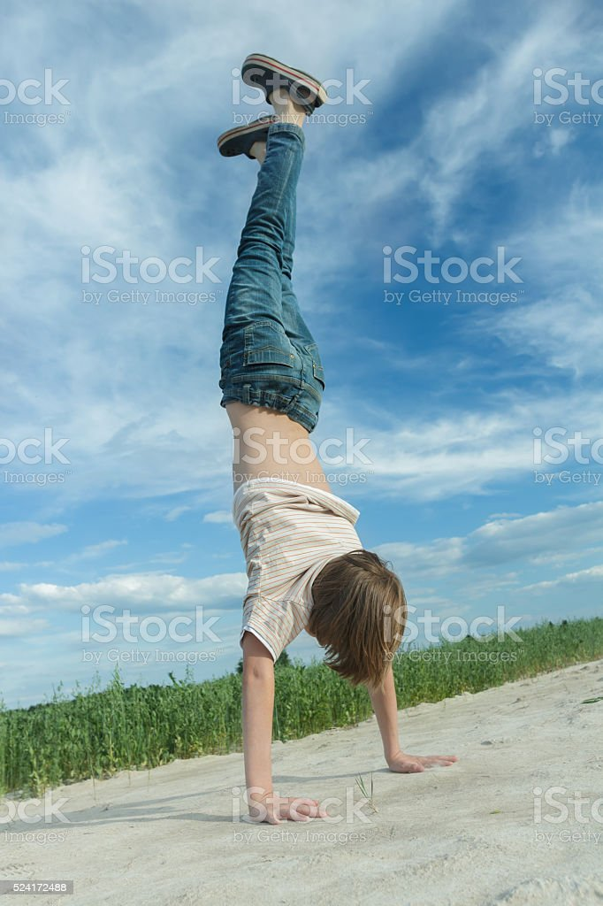 Handwalking of teenager on dirt road at farm field background stock photo