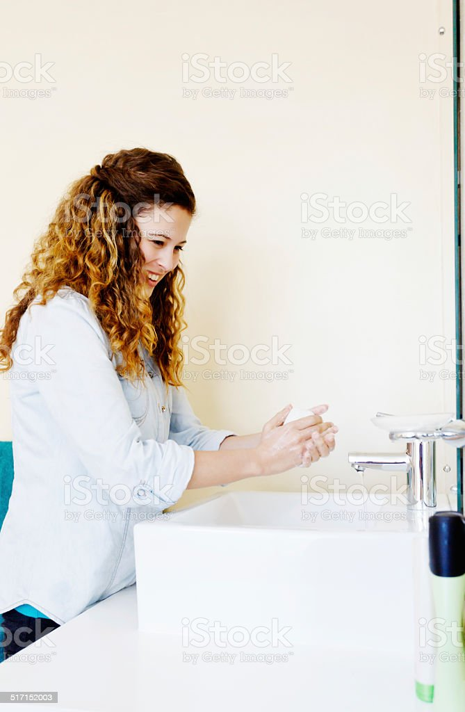 Handwashing helps control the spread of germs; do it regularly! stock photo