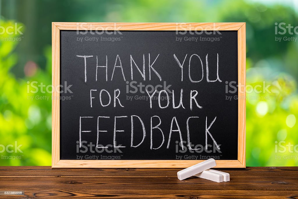 handwriting text thank you for your feedback is written stock photo